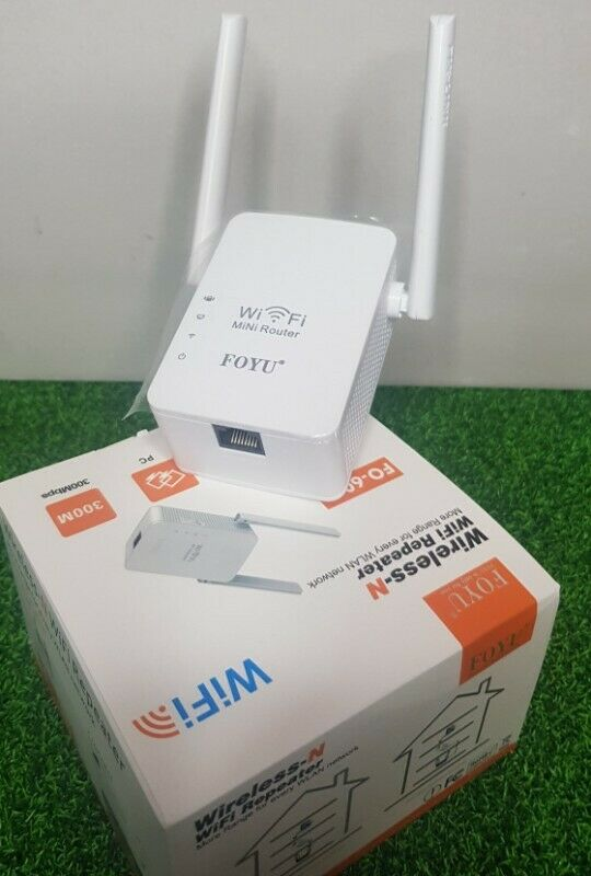 Wireless-N WiFi Repeater Mini Router / Range Extender for All WLAN Networks. Brand New Products.