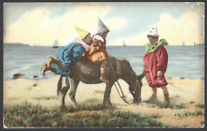 Kids-Climbing-aboard-a-Donkey-on-the-Beach-Vintage-Gale-amp-Polden-Postcard