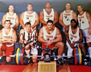 NEBRASKA-FOOTBALL-CHRISTIAN-PETER-55-SIGNED-PHOTO-WEIGHT-ROOM-RECORD-PLATFORM