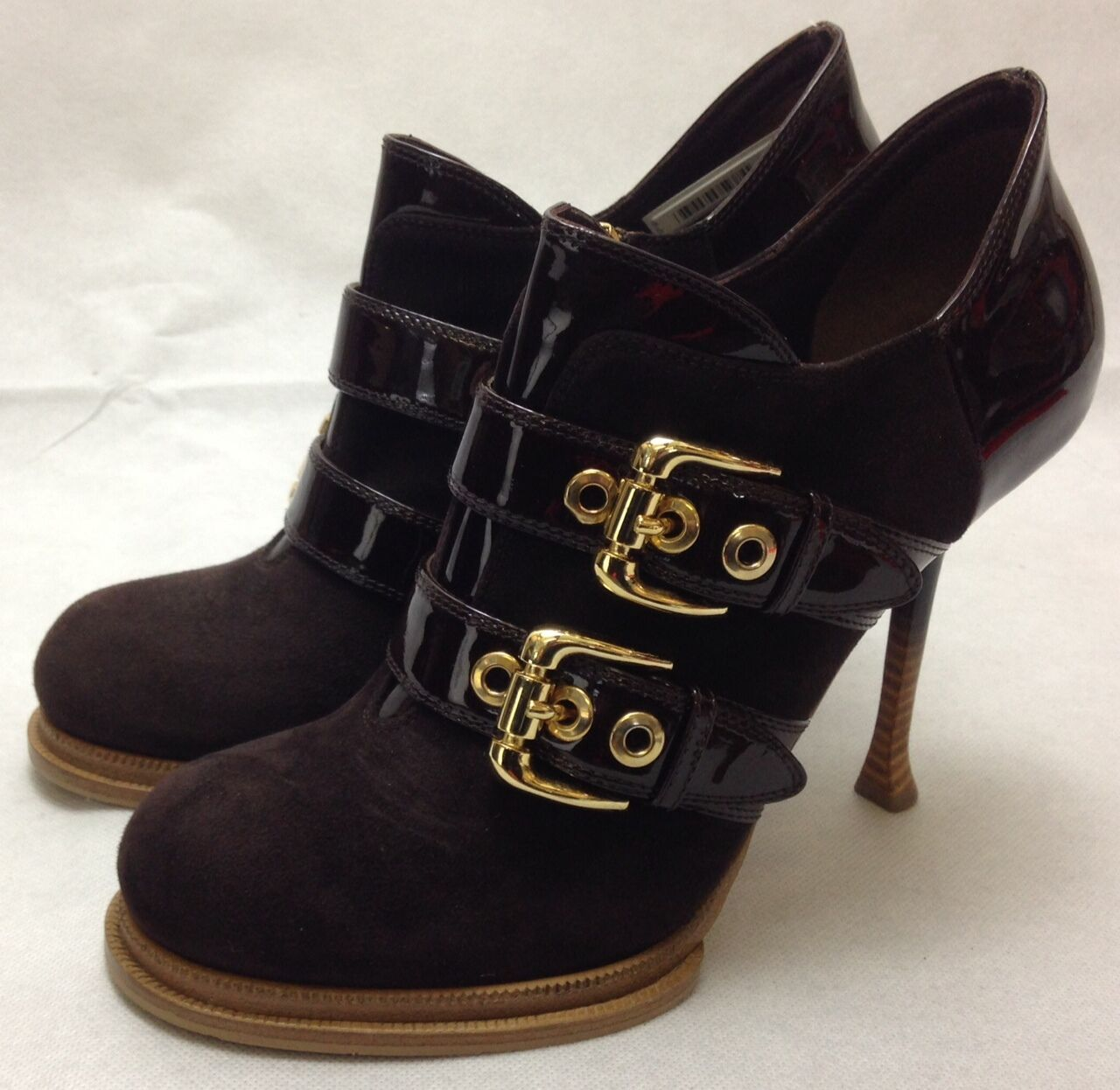 Gianmarco Lorenzi couture brown ankle boots with gold buckles.   Size 40
