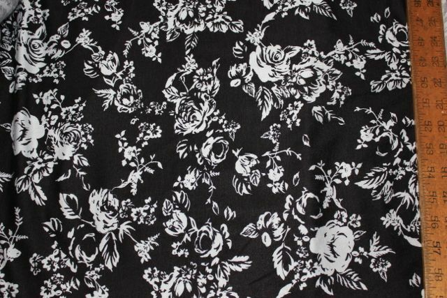Apparel fabric: 100% Rayon Jersey Knit Floral Black White Sewing. by the yard.
