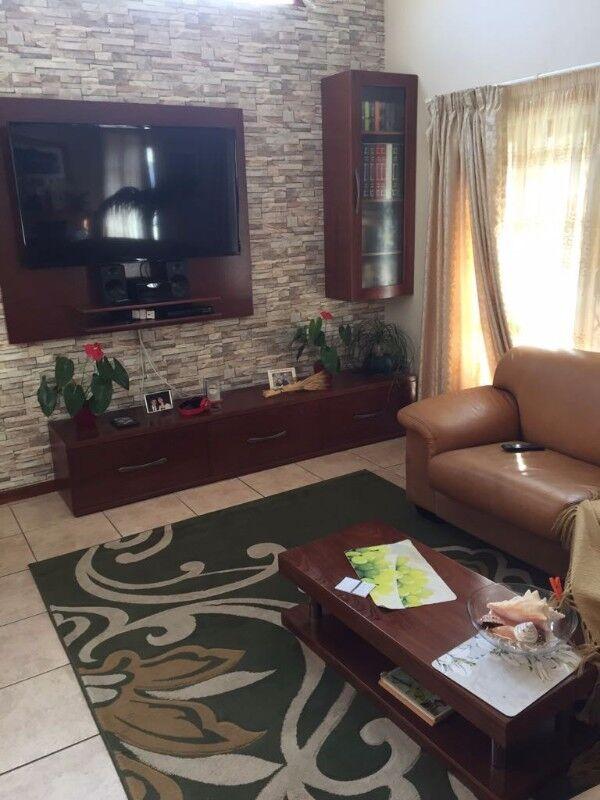 Solid kiaat and verneer furniture