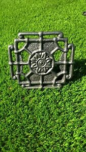 Ornate-cast-iron-trivet-for-fireplace-or-range-with-adjustable-base-item-TV005