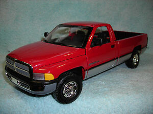 1-18-1995-DODGE-RAM-2500-3-4-TON-SLT-P-U-IN-RED-SILVER-BY-ERTL-AMERICAN-MUSCLE