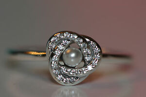 AUTHENTIC-NEW-PANDORA-RING-LUMINOUS-LOVE-KNOT-191040WCP-CHOOSE-SIZE-S925-ALE