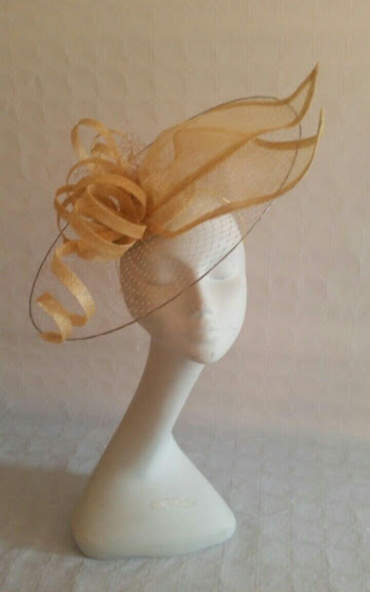 Ladies gold fascinator. Saucer hay Ascot races wedding made to order