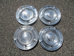 Genuine 1957 1958 Oldsmobile 14 inch hubcaps wheel covers set