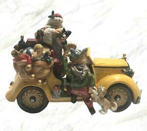Grandeur-Noel-Santa-In-Car-With-Children-Yellow-Antique-Car-Porcelain-Figurine