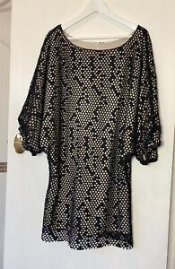 Shona-Joy-12-black-and-tan-laser-cut-dress-with-3-4-sleeves