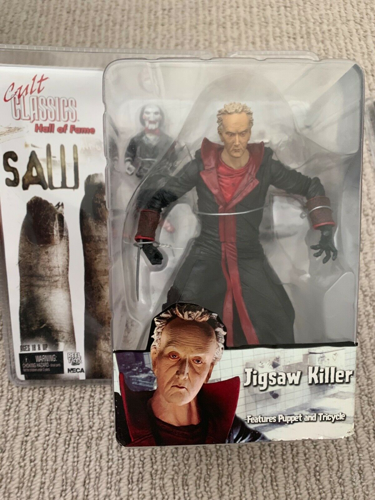 SAW  Jigsaw Killer Htutti Of Fame Cult classeics cifra by NECA
