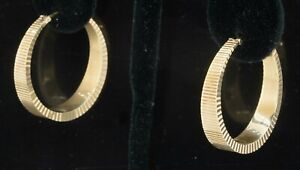 Designer signed vintage 14K gold fancy textured graduated width hoop earrings