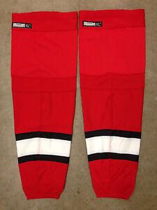 616449f81be REEBOK Edge Pro Stock Hockey Shin Pad Socks Carolina Hurricanes Red ...
