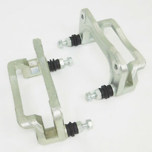 2x-Saddle-Holder-Brake-Calliper-Carrier-Rear-Axle-L-R-Hyundai-Santa-Fe-II-cm