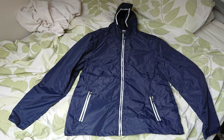 Lifestyle corner bluee rain coat. New. XL