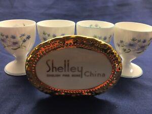 SHELLEY-BLUE-ROCK-FLOWERS-DAINTY-FOUR-EGG-HOLDERS-13591-BLUE-TRIM