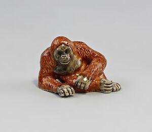 9982083-Monkey-Miniature-Porcelain-Figurine-Orangutan-Lying-5-5x3-5cm