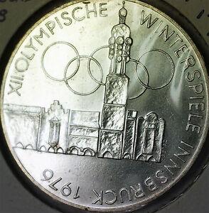 1976-Austria-100-Schillings-Winter-Olympics-Building-Brilliant-Silver-Coin