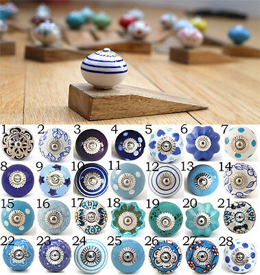 Ceramic door knob on wooden door stop.Choose your design. Blue white patterned.