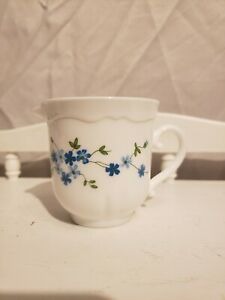 Arcopal-France-White-Cream-Pitcher-with-light-blue-dark-blue-flowers-green