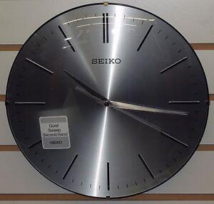 seiko 12 silver finished dial w black trim wall clock