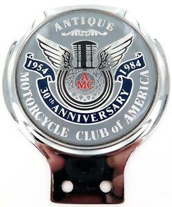 ANTIQUE-MOTORCYCLE-CLUB-OF-AMERICA-1954-1984-ANNIVERSARY-GRILL-BADGE