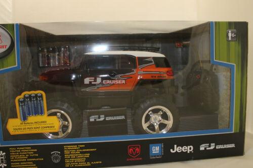 Elektrisches Spielzeug R/C Toyota FJ Cruiser schwarz/orange