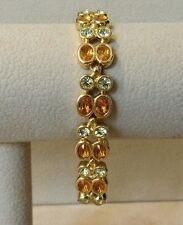 JOAN RIVERS CLEAR & AMBER CITRINE COLORED STONES SET IN GOLD TONE BRACELET