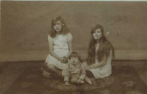1900-039-s-VINTAGE-West-amp-Son-REAL-PHOTO-2-YOUNG-GIRLS-amp-BOY-FAMILY-POSTCARD-UNUSED