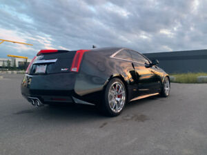 Cadillac CTS-V coupe six speed manual. 8000kms