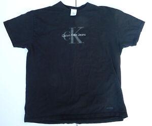 24abfff1b Vintage 90s Calvin Klein Jeans Men's Black Spellout Logo T Shirt ...