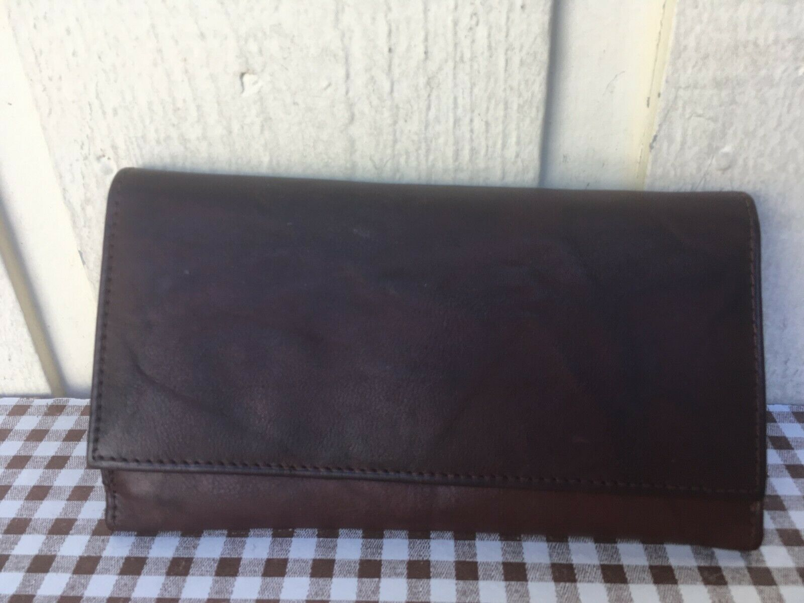Made in India of genuine leather women's trifold wallet. Brown