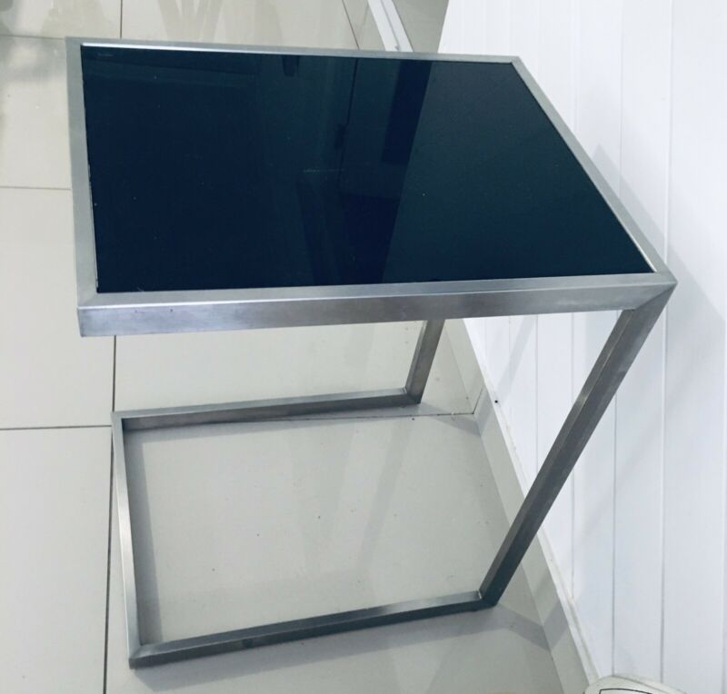 Side table in steel and black glass top