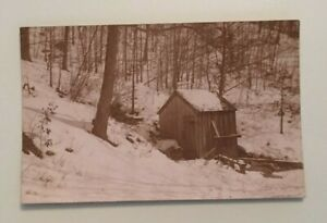 VINTAGE-POSTCARD-UNUSED-SHED-IN-THE-WOODS-SNOW-ON-THE-GROUND-PENNY-PC