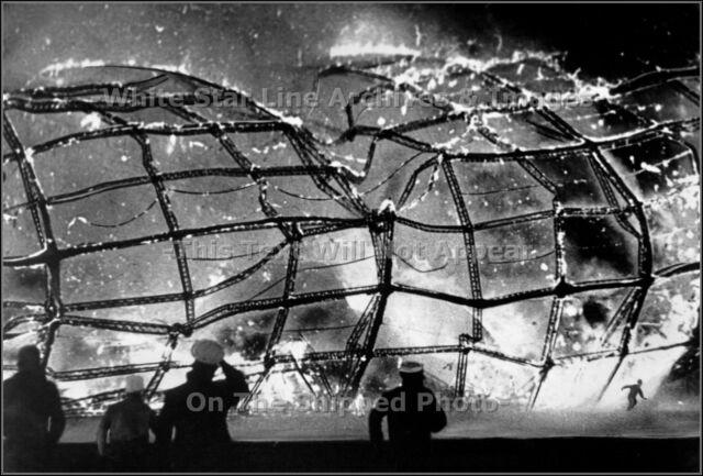 Photo: A Survivor Flees Burning Hindenburg At Lakehurst, NJ - May 6, 1937