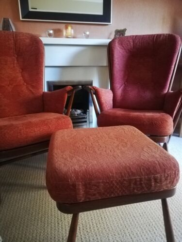 Two Vintage Ercol 'Evergreen' armchairs and accompanying footstool