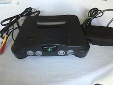 Pre-Owned NINTENDO 64 (N-64) BLACK WITH JUMPER PACK AND CORDS TESTED AND WORKING
