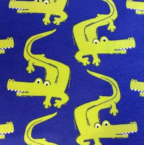 1.5m wide by the 0.5m Navy Green Crocdiles on Soft Back Cotton Jersey Fabric