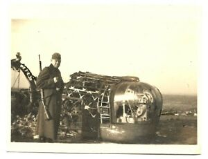 GERMAN-MILITARY-PHOTO-GERMANY-WWII-SOLDIER-NEAR-A-PART-OF-A-PLANE-PHOTO