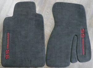 Coverking Front and Rear Floor Mats for Select Chevrolet Spectrum Models Oak 70 Oz Carpet