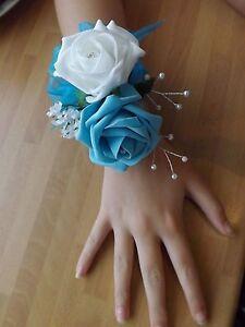 Wedding-flowers-bridesmaids-wrist-corsage-turquoise-white-roses-diamante-pearls