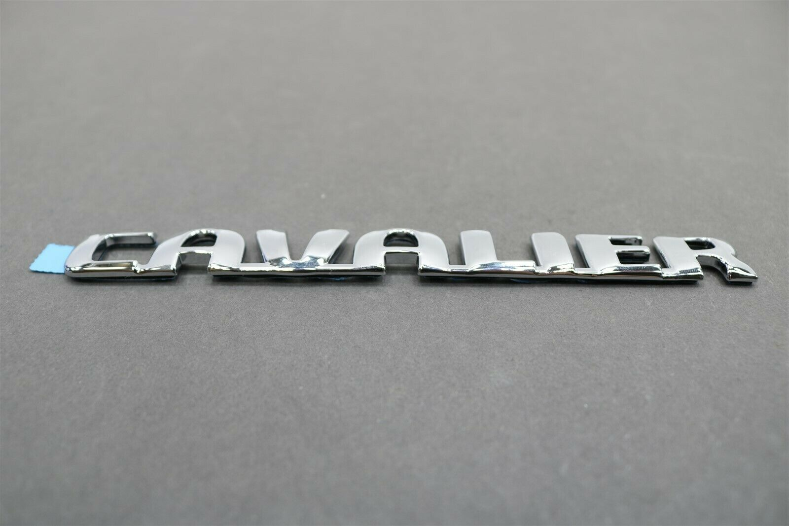 Rear GM Genuine 22611400 Compartment Lid Vehicle Name Plate