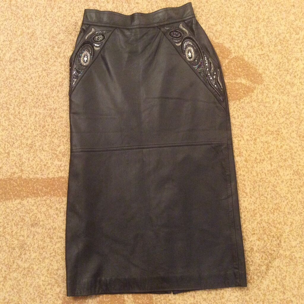 Women's Leather Skirt with decorative details. Size M