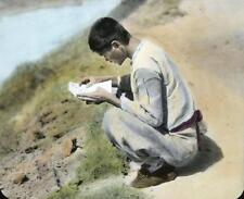 Photo. ca 1914. Korea. Man Sitting on Ground Reading Letter