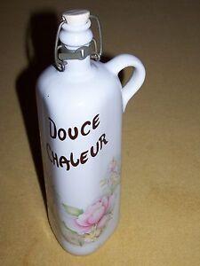 """bouteille Fantaisie """" douce chaleur """" porcelaine France Revol - France - EBay bouteille triangulaire, décorée, fleurie et inscription """" douce chaleur """" hauteur 31 cm fermeture avec bouchon mécanique (manque le petit joint orange) """"logo"""" porcelaine véritable France Revol - France"""