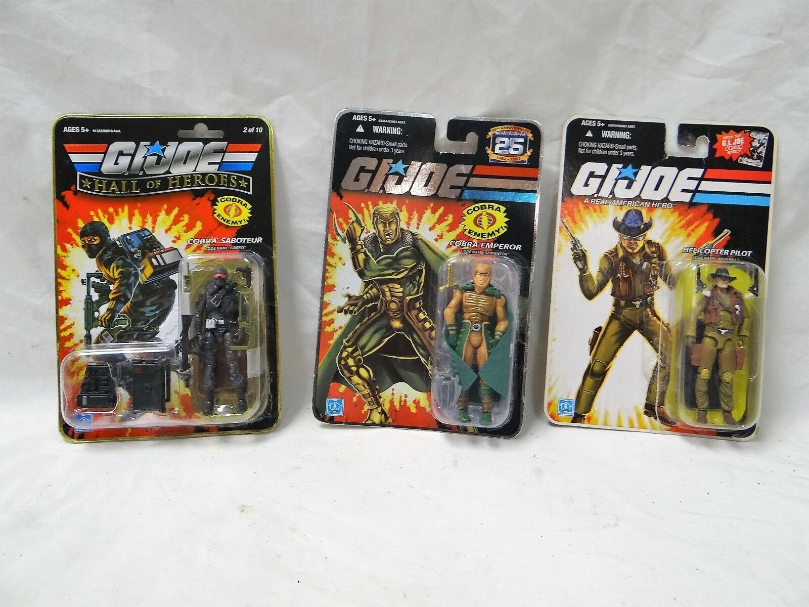 Lot OF 3 G.I Joe Collectible cifras; Cobra Emperor, Helicopter Pilot, & Firevolare