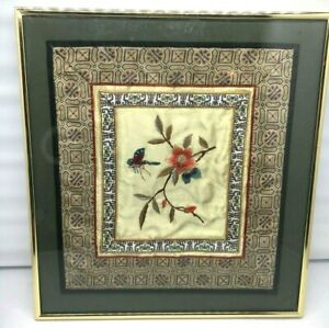 A pair of framed butterfly embroidery
