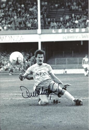 A 12 x 8 inch photo featuring & personally signed by Everton's Derek Mountfield.