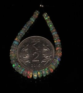 8-58-TCW-3to5-MM-4-034-NATURAL-ETHIOPIAN-FIRE-OPAL-ROUNDEL-BEADS-demi-strand-S6375