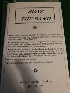 Bob-King-Present-BEAT-THE-BAND-Improved-Ring-off-Rubberband-Magic-Trick