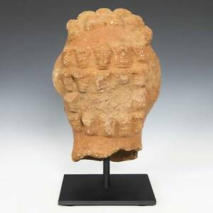 Terracotta statuette of Aphrodite seated on a rock | Greek